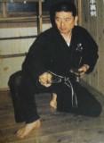 Soke Hatsumi showing how to throw shuriken
